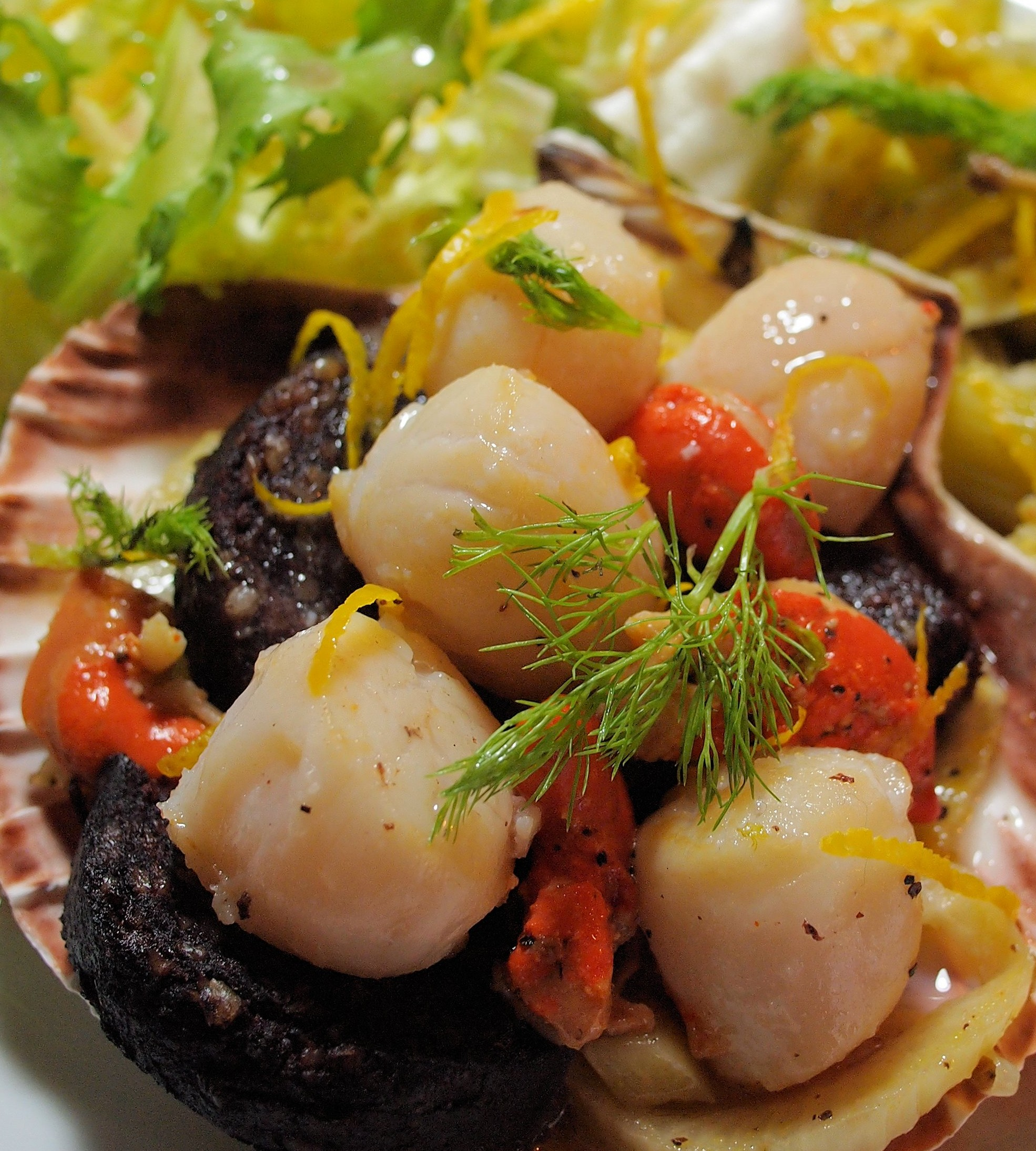 Salad of black pudding and scallops with crisp bacon, apples and hazelnuts