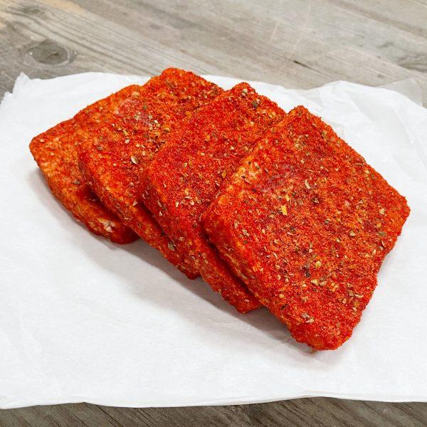 Pork lorne coated in Italian herbs